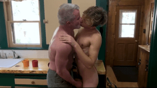 Older man and twink gay kiss