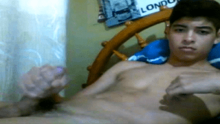 Asian lad twists nipple and jerks penis