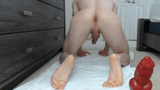 Gay man rides hugh big red cock dildo